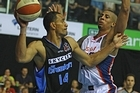 Mika Vukona of the Breakers clears the ball under pressure from Diamon Simpson of the 36ers. Photo / Getty Images