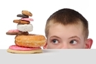 Some research has shown eating high-sugar and high-fat foods may exacerbate symptoms of ADHD. Photo / Thinkstock