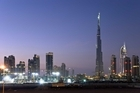 One bank has drawn a link between a skyscraper building boom and impending economic collapse. Photo - the Dubai skyline with the world's tallest building, the 828m Burj Khalifa shown. Photo / Thinkstock