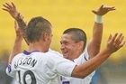 Andrezinho and Joshua Ridson of the Glory celebrate after beating the Wellington Phoenix. Photo / Getty Images
