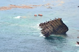 The stern section of the MV Rena is slipping off the Astrolabe Reef. Photo / Maritime NZ
