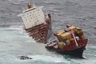 The container ship Rena sits in two pieces on Astrolabe Reef off the coast of Tauranga. Photo / Supplied
