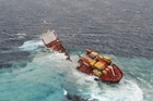 The stricken cargo ship Rena has broken in two after heavy swells in the Bay of Plenty overnight.