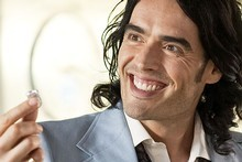 Russell Brand jokingly slipped off his wedding ring in a video before his split with Katy Perry. Photo / Supplied