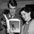 Sir Edmund Hillary and his wife look through the newly published book on the Mt Everest expedition, in Copenhagen, Dec 1, 1953. Photo / File