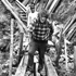 Sir Edmund Hillary working on a footbridge across a gully in the Mt Everest region, 1982. Photo / File