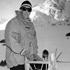 Sir Edmund Hillary on Tasman Glacier with his sledge during dog training, 1956. Photo / File