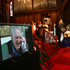 Peter Hillary speaks from the pulpit as his late father appears on a nearby TV screen at his state funeral at St Marys Church, Auckland, Tuesday, January 22, 2008.  Photo / Brett Phibbs