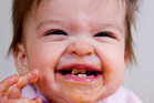 The age that babies are at their ickiest, they're also at their cutest.  Photo / Thinkstock