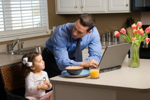 Sometimes parents are forced to bring work home. Photo / Thinkstock