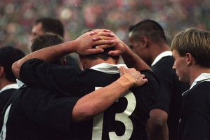 The All Blacks console one anoher after the 1995 Rugby World Cup final. Photo / Geoff Dale