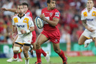 Will Genia of the Reds makes a break to score a try during the round 12 Super Rugby match between the Reds and the Chiefs. Photo / Getty Images.