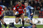 Robbie Fruean of the Crusaders makes a break during the round 13 Super Rugby match between the Crusaders and the Blues at AMI Stadium. Photo / Getty Images.