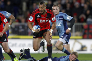 Robbie Fruean of the Crusaders makes a break during the match between the Crusaders and the Blues. Photo / Getty Images.