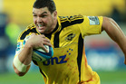 Ben May of the Hurricanes runs the ball during the round 13 Super Rugby match between the Hurricanes and the Brumbies. Photo / Getty Images.