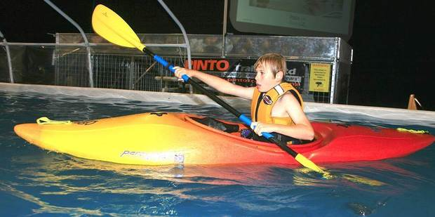 Safely lifejacketed, kids can try their hand at paddling a kayak. Photo / Supplied