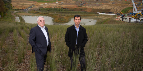 Todd Property Group chief executive Evan Davies (left) and senior development manager Stephen Martin at the site on Auckland's northern outskirts. Picture / Greg Bowker