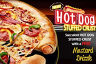 A hot dog stuffed crust pizza will not be on the menu in New Zealand. Photo / Supplied