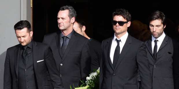 Pallbearers (including Karl Urban, front right) carry the casket from the church at the funeral. Photo / Doug Sherring