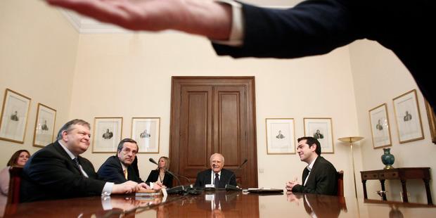 Greek President Karolos Papoulias (centre), Socialist Evangelos Venizelos (L) Conservative Antonis Samaras (second left) and Leftist Alexis Tsipras (R), in coalition discussions in Athens. Photo / AP