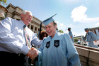 Columbia University janitor Gac Filipaj at graduation. Photo / AP