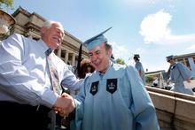 Columbia University janitor Gac Filipaj at graduation. Photo / AP