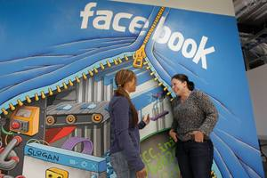 Two workers chat each other at Facebook headquarters in Menlo Park, California. Photo / AP