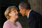 President Barack Obama greets German Chancellor Angela Merkel before the G8 Summit. Photo / AP