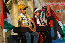 Palestinian children hold a key symbolizing the keys to houses left by Palestinians in 1948. Photo / AFP