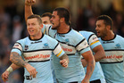 Todd Carney, Andrew Fifita of the Sharks and team mates celebrate winning the round 10 NRL match between the Cronulla Sharks and the Melbourne Storm. Photo / Getty Images.
