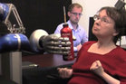 In a clinical trial, a woman used the BrainGate system to mentally control a robotic arm and reach for a drink. Photo / BrainGate Collaboration.