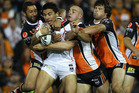 Ben Henry of the Warriors is tackled during the round 11 NRL match between the Wests Tigers and the Warriors at Leichhardt Oval. Photo / Getty Images.