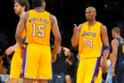 Los Angeles Lakers guard Kobe Bryant, second from right, gives a thumbs up to forward Metta World Peace, second from left, Photo / Getty Images.