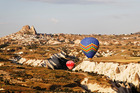 Blue and red hot air balloons float above Uchisar. Photo / Thinkstock