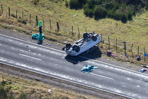 Police and firecrews at the scene of a vehicle rollover crash near Turangi that claimed the lives of three people. Photo / John Cowpland