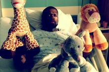50 Cent tweeted this photo of himself purportedly recovering in hospital from a stomach virus. Photo / Twitter 