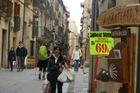 A shop sign in Viana points the way to journey's end at Santiago. Photo / Simon Winter