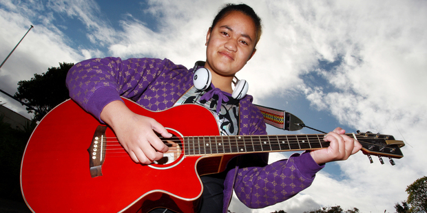 Singer and guitar player Legalo Tumana, 16, poses before auditioning for 'New Zealand's Got Talent' at Wellington Girls East College. Photo / Getty Images