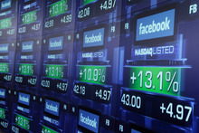 Electronic screens show the price of Facebook shares after they began trading. Photo / AP