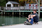 Pete Head and his son, Theo fish off the wharf. Photo / Sarah Ivey