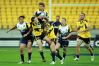 Michael Hooper of the Brumbies takes a high ball under pressure from the Hurricanes. Photo / Getty Images