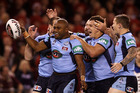 Akuila Uate of the Blues celebrates with team mates after scoring the opening try during game one of the ARL State of Origin series. Photo / Quinn Rooney