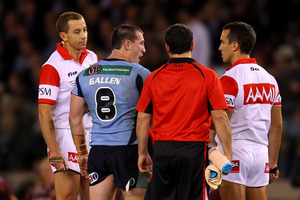Paul Gallen of the Blues talks to the referees after a Maroons try. Photo / Getty Images