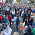 Auckland university students block traffic at the intersection of Symonds Street, Grafton Road and Alfred Street. Photo / Steven McNicholl