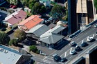 Street-level corner view of properties at 246 Khyber Pass Rd and 4 Huntly Ave. Photo / Supplied