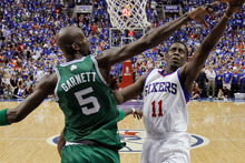 Philadelphia 76ers' Jrue Holiday, right, goes up for a shot as Boston Celtics' Kevin Garnett defends during the second half of Game 6. Photo / Getty Images.