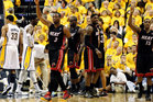 Miami Heat's Dwyane Wade (3), Joel Anthony, LeBron James, and Mario Chalmers (15) celebrate after Wade scored while drawing a foul against the Indiana Pacers. Photo / Getty Images.