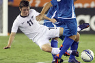 New Zealand's Marco Rojas (11) gets roughed up by El Salvador's William Osael Romero (8) and Dennis Jonathan Alas Morales during the first half of an international friendly soccer game. Photo / AP