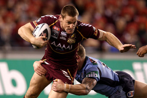 Brent Tate of the Maroons is tackled during the match against Queensland. Photo / Getty Images