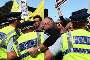 Protests erupted during John Key's post-Budget address. Photo / Getty Images